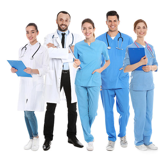 A healthcare team with three medical assistants.