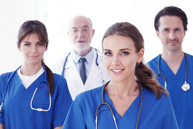Medical assistants with a doctor.
