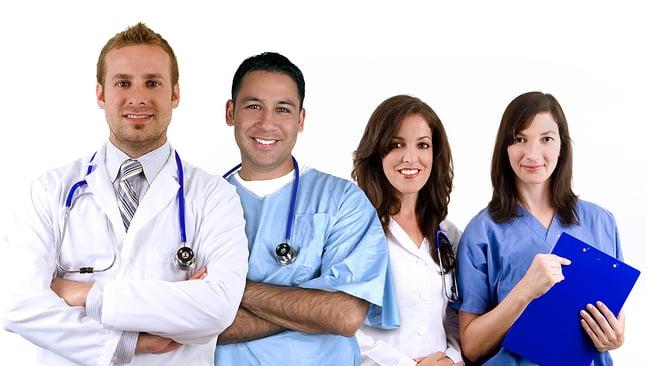 Smiling medical team standing together.
