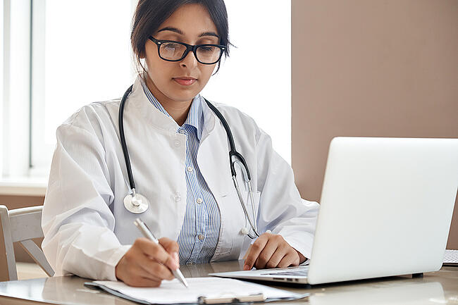 Medical student working on a laptop.