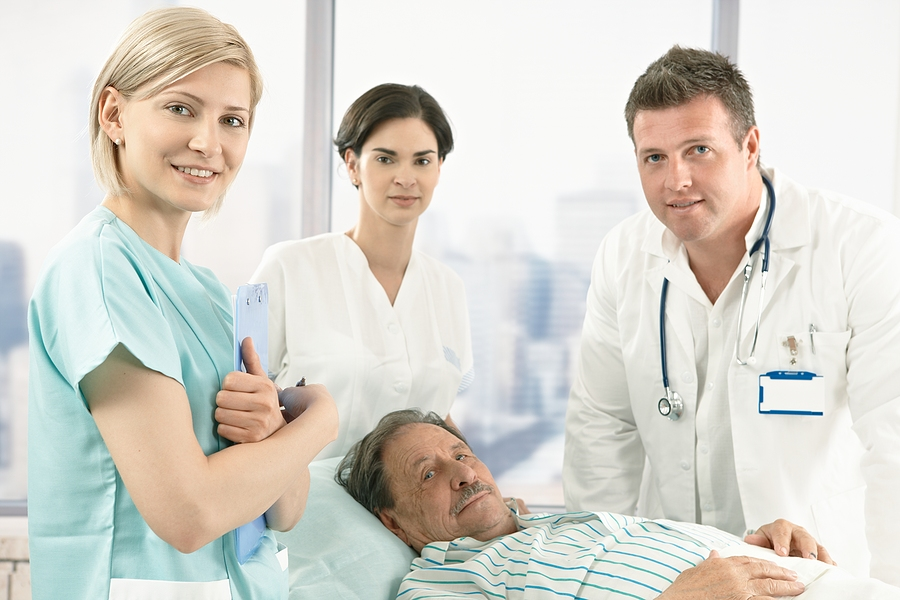 Medical assistant and staff with a patient.