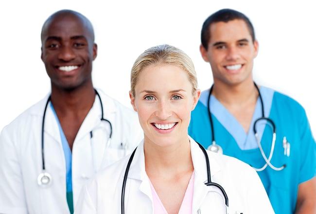 Medical team including a nurse, doctor, and medical assistant standing together.