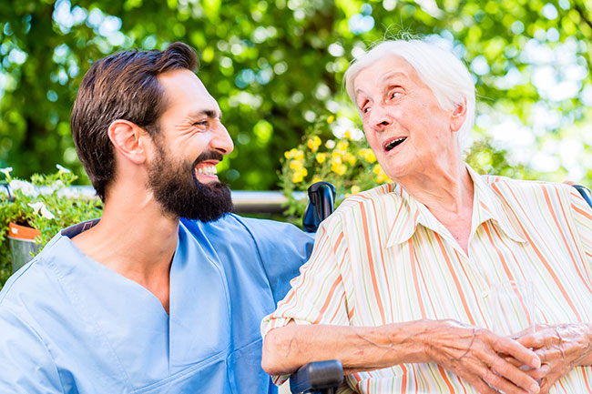 nurse-having-chat-with-senior--.jpg