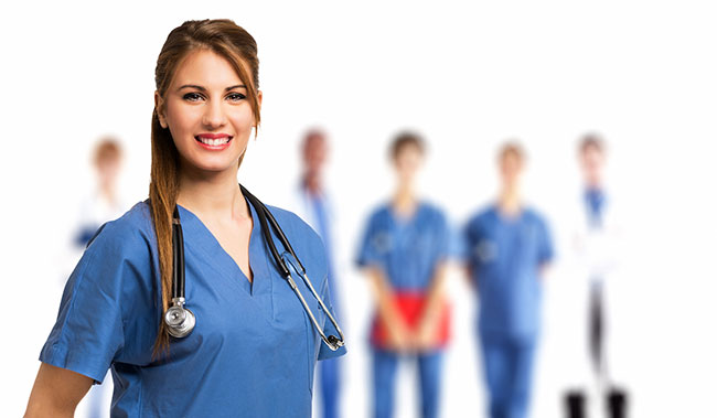 smiling-nurse-in-front-of-her-team-advance-athenacareeracademy.jpg