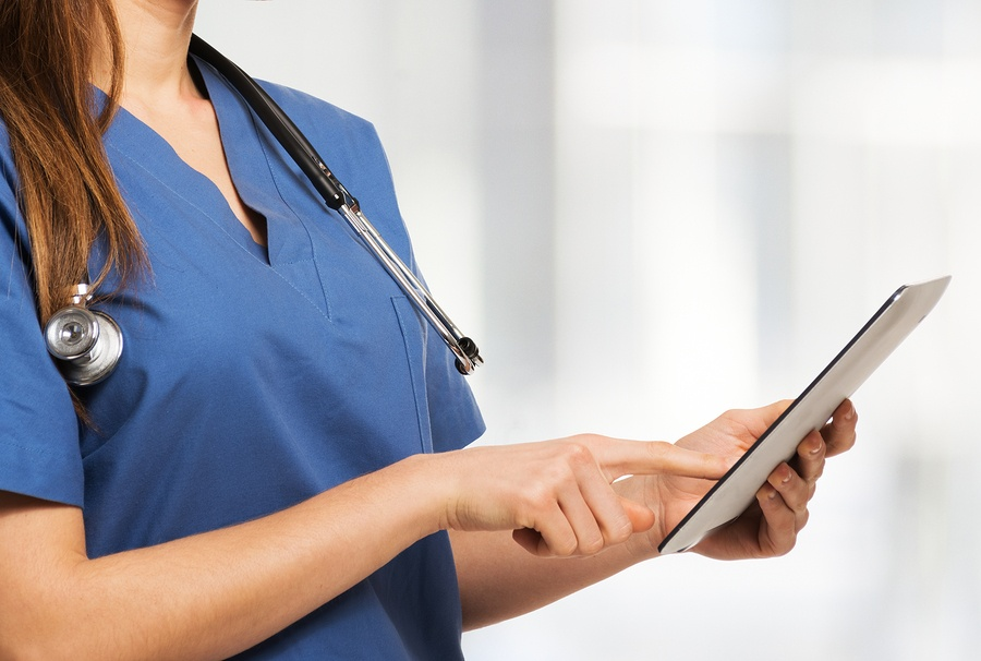 bigstock-Detail-of-a-doctor-using-a-dig-99561122